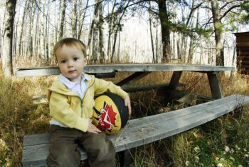 """""""A boy and his ball"""" by Around the bend is licensed under CC BY 2.0"""